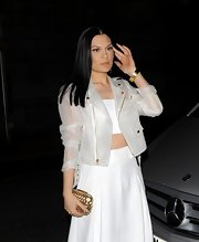 Jesse J added a little edge to her maxi skirt and tube top combo with a white, transparent motorcycle jacket.