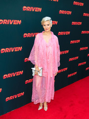 Maggie Grace topped off her dress with a matching cape.