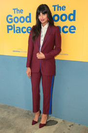 Jameela Jamil attended the FYC screening of 'The Good Place' wearing a burgundy pantsuit with blue trim.