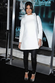 Kim Kardashian looked demure at the premiere of 'Unknown' in gray platform Boulima watersnake pumps with chain-trimmed toes.