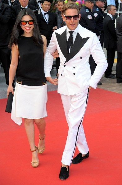 Lapo Elkann wore an innovative white suit featuring black lapels and trim to the Cannes Film Festival.