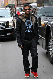 Usher strolled through town in a fur lined hooded sweat shirt.