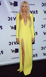 Havana Brown was all dolled up for the VH1 event wearing a floor-length dress with a plunging neckline and thigh-high slit.