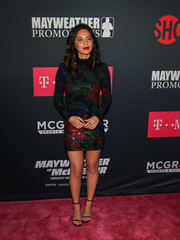 Olivia Munn looked effortlessly glam in a beaded mini dress by Balmain at the Mayweather vs. McGregor pre-fight party.