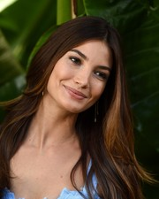 Lily Aldridge wore a flippy center-parted hairstyle during the Sexiest Push Ups celebration.