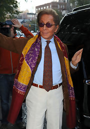 Valentino jazzed up his casual outfit with a paisley print tie and a printed scarf.