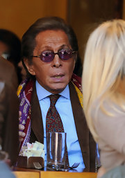 Valentino paired his printed scarf with round purple shades.