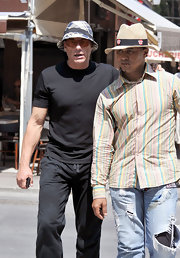 Jean-Claude Van Damme's plaid bucket hat was a fun finish to his black outfit.