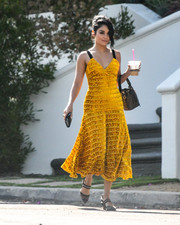 Vanessa Hudgens styled her dress with a pair of slingback pumps, also by Fendi.