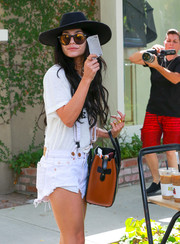 Vanessa Hudgens teamed her hat with a pair of mirrored shades by Wildfox.