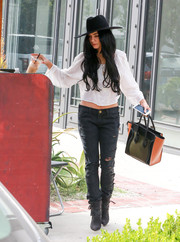 Vanessa Hudgens teamed her cute top with ripped black jeans by Current/Elliott.