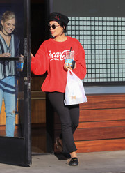 Vanessa Hudgens paired her top with black flare jeans by L'Agence.