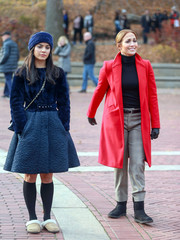 Jennifer Lopez stayed warm in black sheepskin boots and a red coat on the set of 'Second Act.'