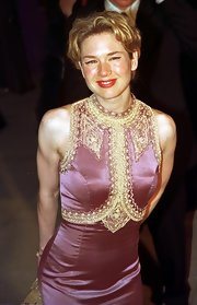 Renee Zellweger wore her dirty blond locks short and in center-parted ringlets.