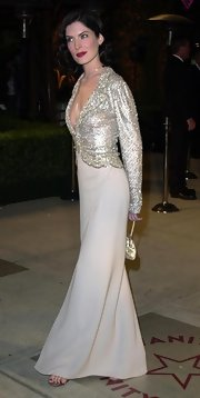 Lara Flynn Boyle looked daringly glamorous in a dangerously decollete glittery blouse.