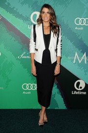 Nikki Reed complemented her jacket with an elegant black pencil skirt by Stop Staring.