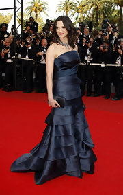 Asia Argento's fondness for satin purses once again showed as she carried one at the Cannes screening of 'Vengeance.'