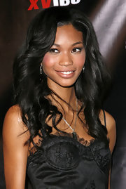 Chanel Iman showed off bouncy curls while attending the Vibe magazine party.