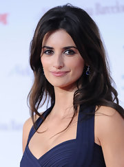 Penelope Cruz kept her hair in a simple center part hairstyle while attending the 'Vicky Cristina Barcelona' show.