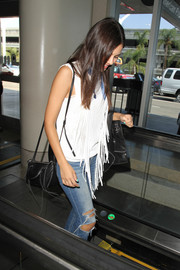 Victoria Justice caught a flight out of LAX carrying a fringed black shoulder bag.