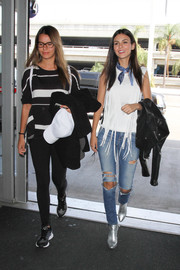 Victoria Justice was grunge-chic on the bottom half in a pair of torn jeans.