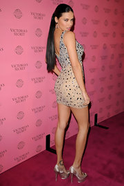 Adriana Lima sizzled on the pink carpet at Victoria's Secret 2011 Swim collection launch. The supermodel pulled her tresses back in a sleek ponytail. A subtle center part completed her polished look.