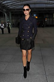 Victoria dons a slim fitting Burberry Prorsum wool coat in Heathrow airport.  For Victoria, the world is her runway!