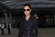 Victoria Beckham arrives at Heathrow International Airport looking stylish as ever.
