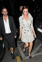Victoria wore super chic RTW Spring 2010 trench coat with a ruched knotted detail on the skirt and a tied belt waist.