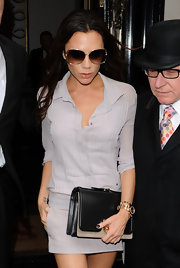 Victoria Beckham looked chicly sophisticated in a lilac button-down silk blouse while out at a restaurant.