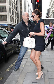 "Looks like Victoria has a new favorite shoe designer. The fashionista was spotted wearing the ankle-strapped ""Zenith"" platform pumps-one of her many Atwood heels."