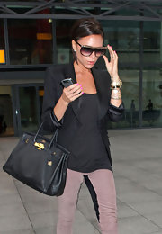 Victoria Beckham's collection of Hermes bags has a worth estimated in the millions. This classic Birkin bag goes with any ensemble.
