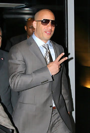 Vin looks official in a gray pinstripe suit and shield aviator shades.