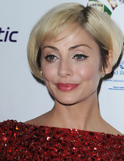 Natalie Imbruglia added a retro touch to her look with cat eyes.