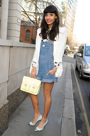 A crisp white blazer dressed up Jameela's cute denim overalls during London Fashion Week 2012.