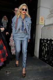 Rita Ora added spice to her outfit with animal print platform pumps.