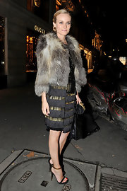Diane wears a luxe fur coat over her Gucci dress for the Gucci Rue Royale Reopening party.