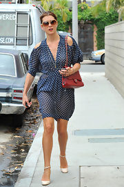 Kate Walsh paired her polka dot dress and ivory pumps with a red quilted leather handbag.