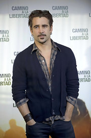 Colin Farrell paired his plaid shirt with a navy cardigan at 'The Way Back' photo call.