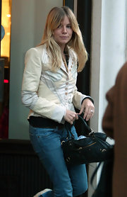 Sienna Miller wore a cream patchwork blazer while running errands in London.