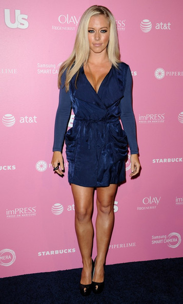 Kendra's conservative navy dress still managed to show off the Playboy bunny's favorite assets.