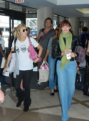 Jessica Sutta arrived at LAX with a green scarf wrapped around her neck.