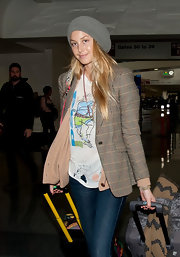 Whitney Port wore a slouchy beanie with her eclectic airport ensemble.