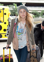 Whitney Port kept California casual underneath a plaid blazer and boyfriend cardigan with a ripped up graphic T-shirt.