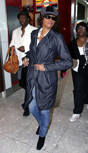 Whitney Houston was seen at Heathrow Airport wearing a denim trenchcoat.
