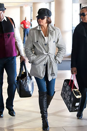 Whitney Houston wore a light weight short trench at LAX.