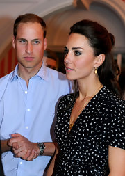 Prince William showed off his strong jaw line with his signature short 'do at a Youth Reception with Kate.