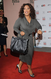 Oprah Winfrey pulled her look together with a pair of silver Christian Louboutin peep-toes at the Women in Entertainment Breakfast.