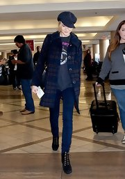 Evan Rachel Wood topped off her travel look with a wool newsboy cap.
