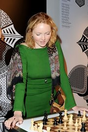 Lily Cole styled up her plain dress with a colorful print scarf when she attended the World Chess Grand Prix.